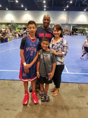 Geary husband, dad and coach who is impacting his family with his craft